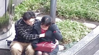 Cute Japanese chick gets her chest fondled at a public park