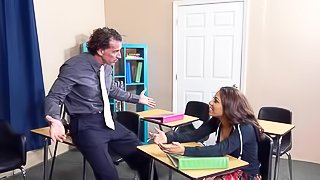 Flirtatious hot ass student girl Sophia Torres in short skirt and sexy pink panties flashes her round butt before teacher sticks his hard dick in her eager mouth. She sucks his pole with enthusiasm in the classroom