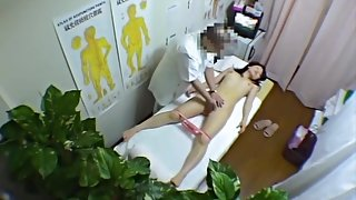 Voyeur cam in massage parlor shooting Asian gal rubbed down dvd 02
