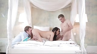 Two guys enjoy oral sex with a gorgeous brunette girl
