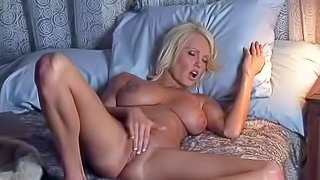 Hanna Hilton is a perfect bodied blonde with big boobs and nice smooth pussy. Nude woman spends evening stroking her bald pussy. Watch lovely massive boobed lady have fun in the bedroom