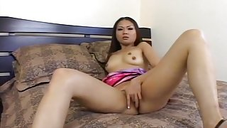 Alluring Asian Finger Fucks Herself