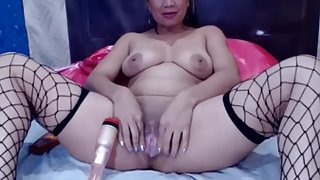 Asian mature slut dildos her twat on webcam